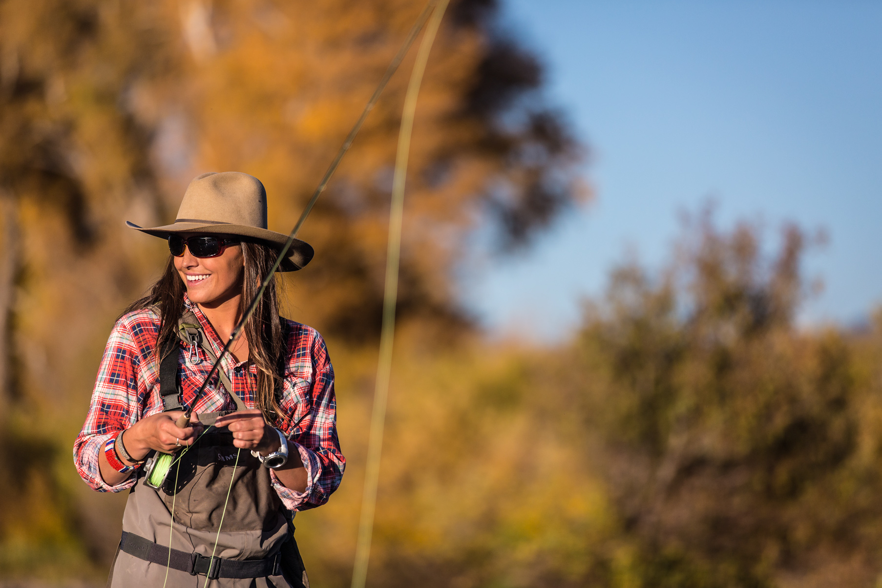 woman-portrait-fly-fishing-colorado